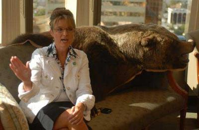 Palin has a dead grizzly as a throw on her office sofa. (Photo - grizzlybay.org)